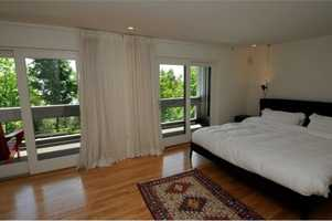 The master bedroom suite is spacious and tranquil overlooking lake and mountain views.