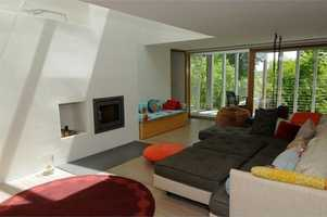 With such a large cozy couch, charming modern fireplace and great view, what more could you want.
