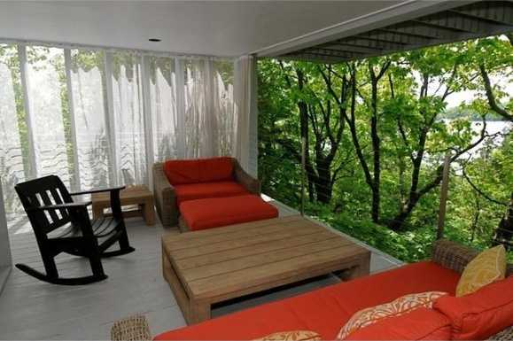 From this balcony, you're tucked away behind the lush trees.