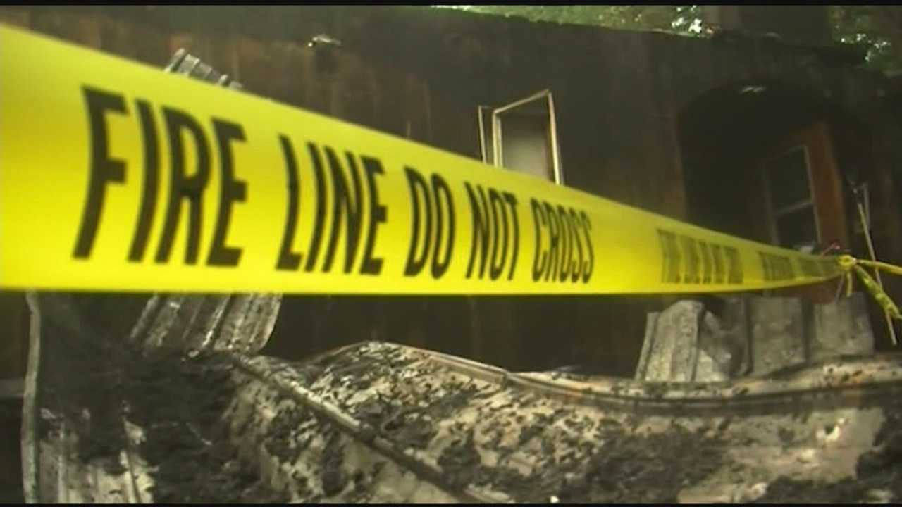 Crews fighting fire while lightning struck