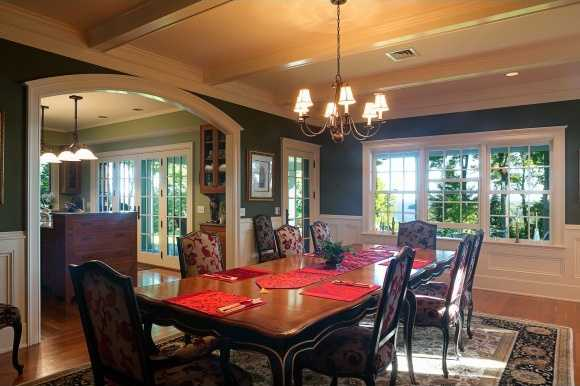 Traditional decor in the dining room is complemented by classic Lake Champlain and Adirondack views.