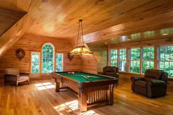 Natural-toned wood and sunlight flows in this pool parlor/ man cave.