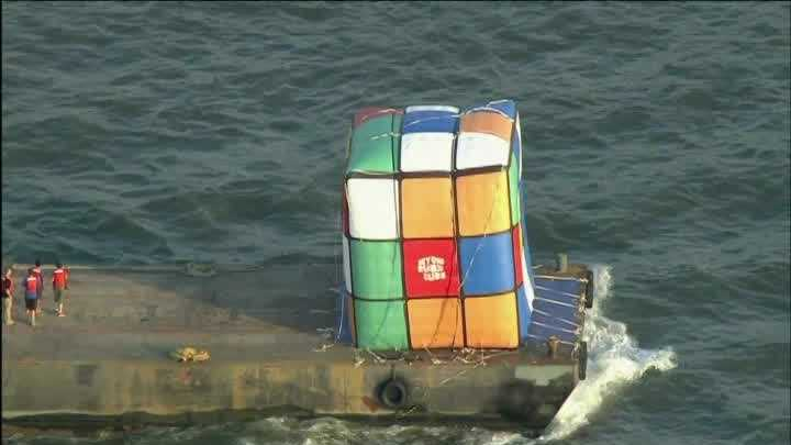 Giant Rubik's Cube floats down NYC river