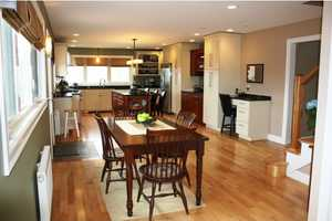 The spacious kitchen is well-appointed with Brazilian granite, top-quality cabinetry, and high-end appliances.