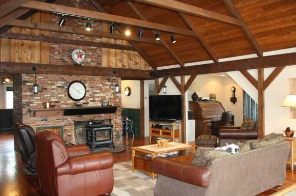 Family room features an old fashion fire place and brick mantle.