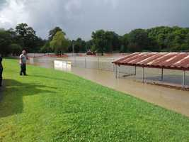 Flood waters cover a baseball field in Chester, Vt.