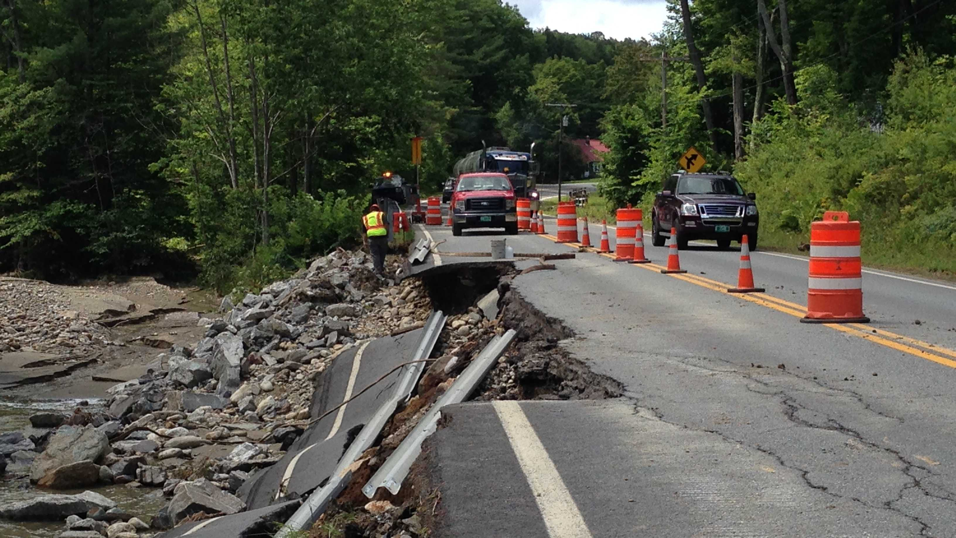 A road was washed out July 28, 2014, by flooding in Chester, Vt.