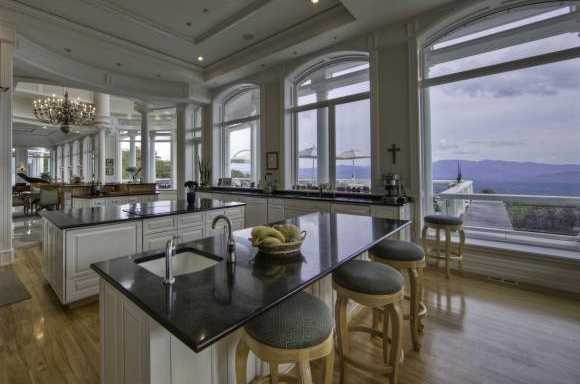 The kitchen features two large cooking islands, offering every gourmet amenity you could desire in the kitchen.