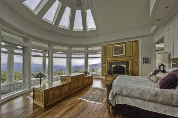 The tremendous master bedroom boasts panoramic views, sky lights, and fireplace.