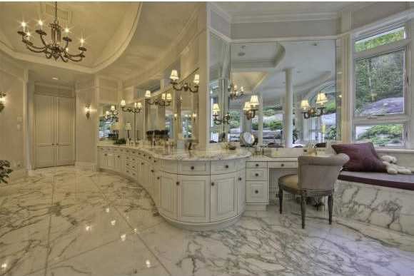 Master bathroom features the finest marble flooring and lengthy vanity.
