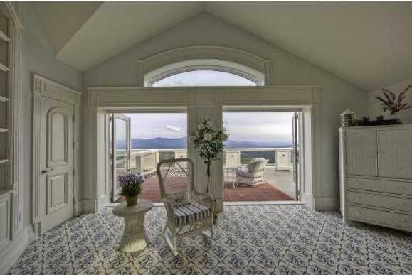 Plus, this guest suite boast this generous balcony.