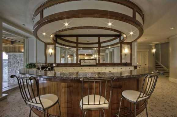 The finished basement features an impressive bar.