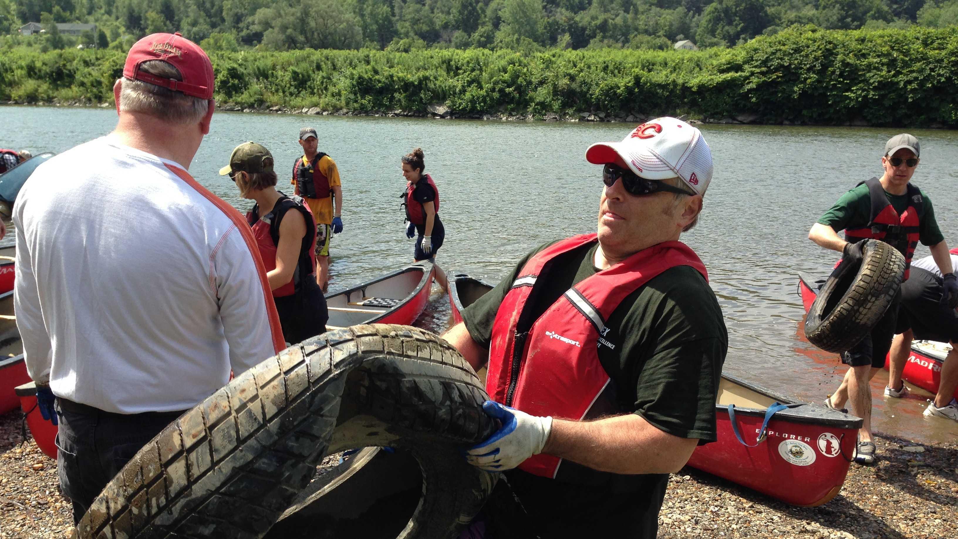 Keurig Green Mountain volunteers are finding lots of tires hidden in the bed and banks of the Winooski River in Waterbury this week.