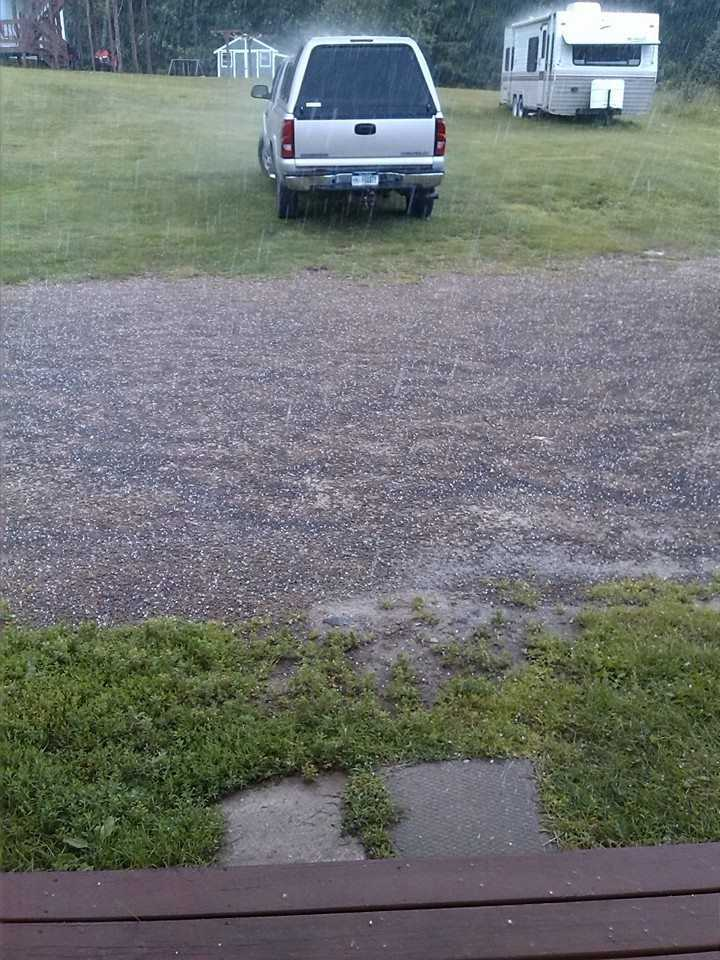 Hail bounces off vehicles and outbuildings in Peru, New York.