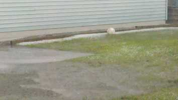 A lonely soccer ball in a sea of hail in Keeseville, New York.