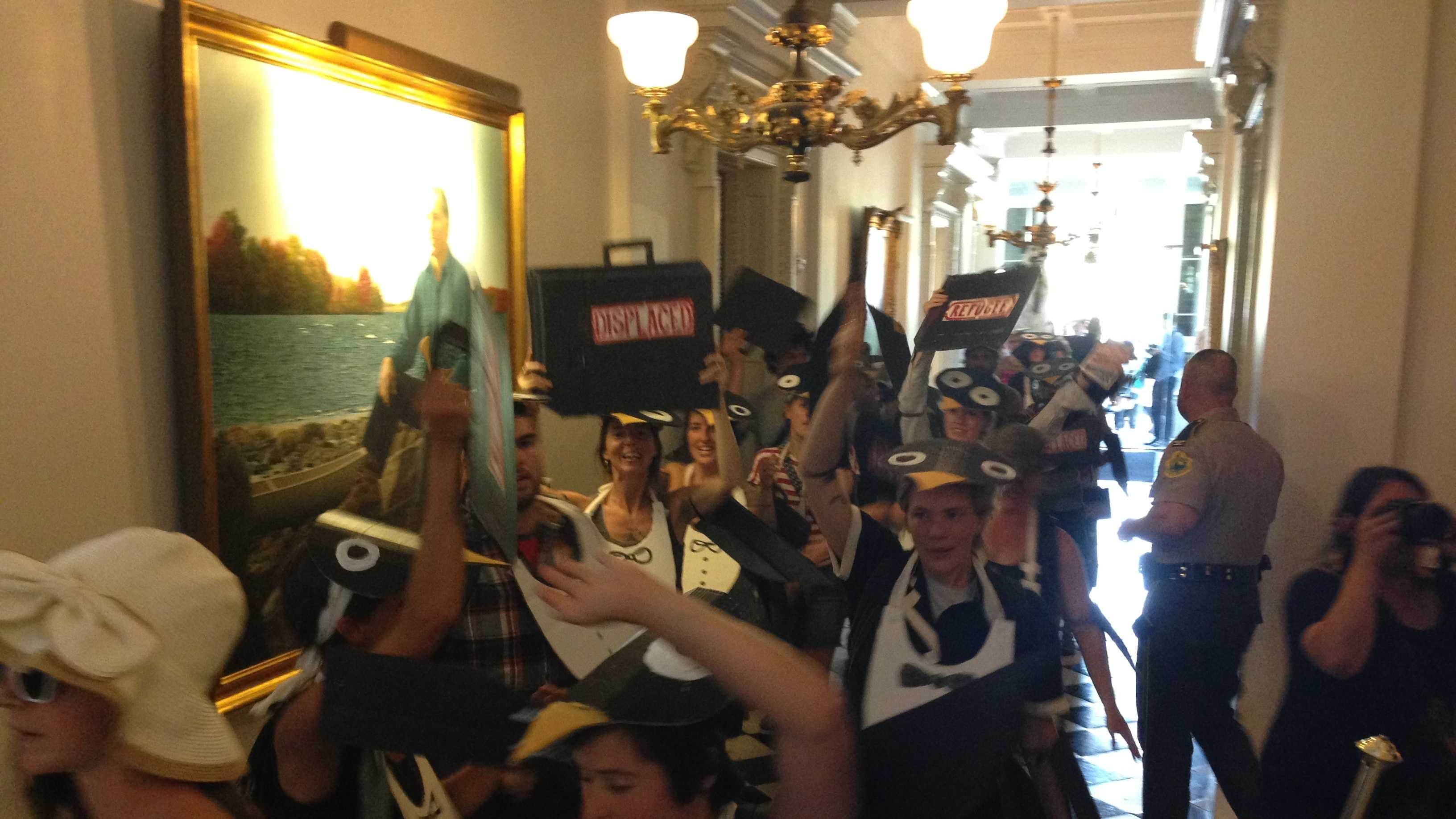 Members of the group Rising Tide stage a raucous protest at the Statehouse Monday, disrupting some hearings inside. The group is unhappy with Gov. Peter Shumlin for supporting budget cuts and a new natural gas pipeline.
