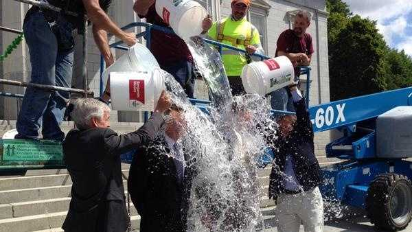 Vermont Governor Peter Shumlin and Lt. Governor Phil Scott take part in the ALS Ice Bucket Challenge. The duo were doused Barre Mayor Thom Lauzon, Montpelier Mayor John Hollar and a team of people working from a crane.