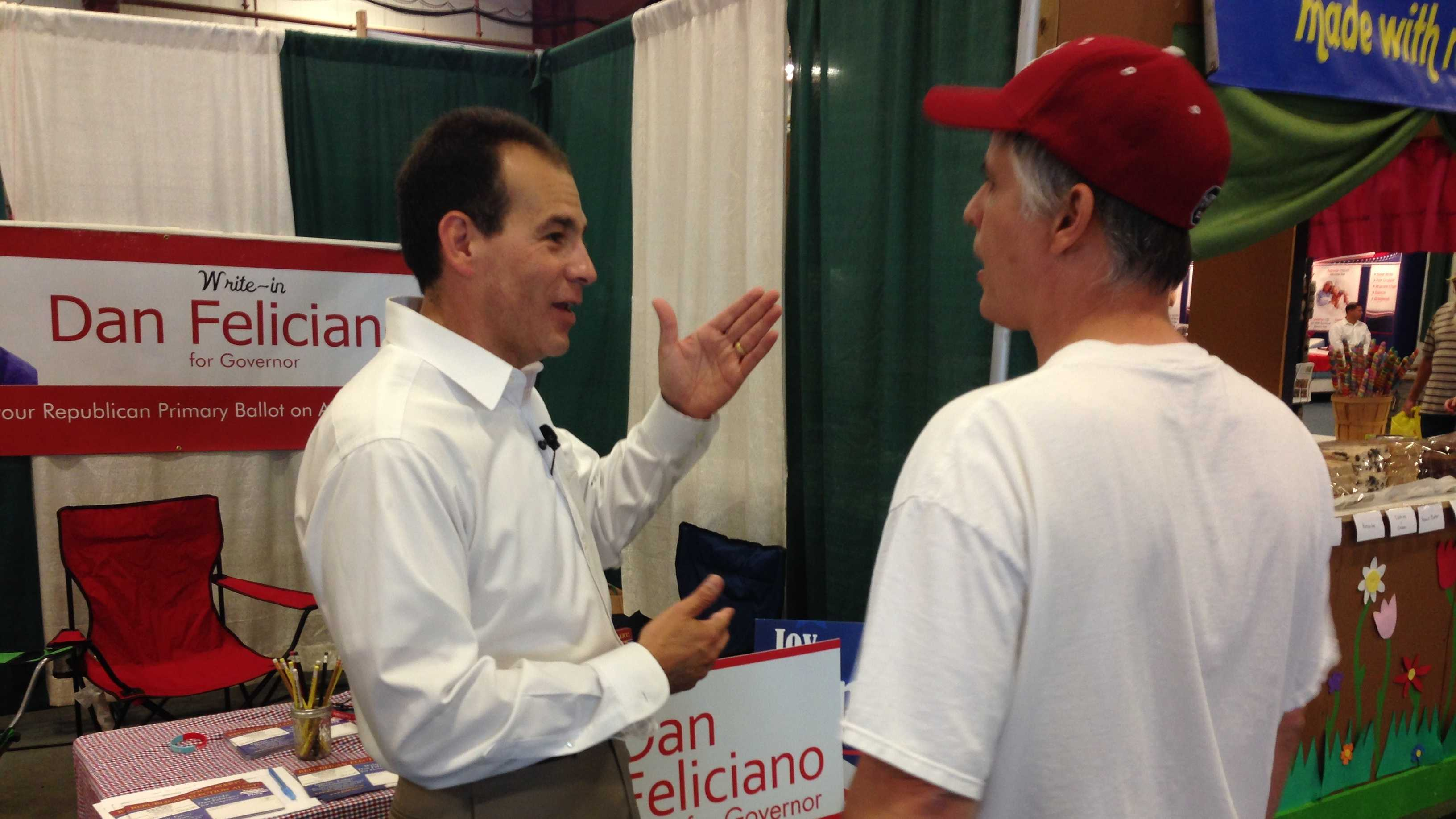 GOP write-in candidate for governor Dan Feliciano talks with an voter Monday at the Champlain Valley Fair.