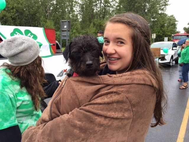 Okay, so it rained.  Snuggling up in a blanket with a puppy to stay warm while waiting to march.