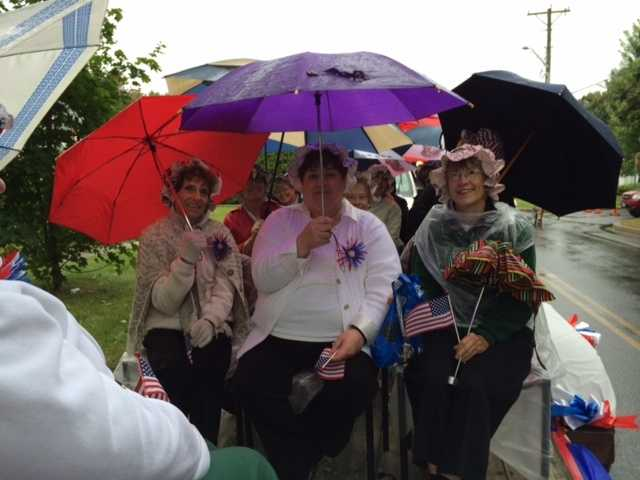 Sweet Adelines came prepared with umbrellas.