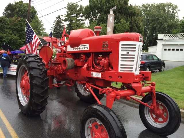 Awesome classic tractor in parade.
