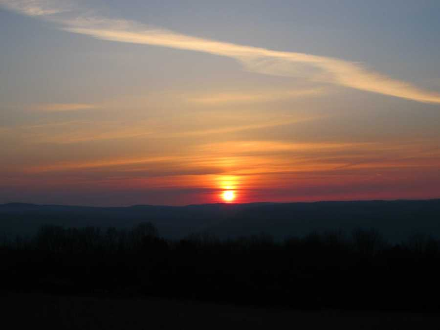 I really enjoy photography. I don't own anything special for a camera – but I captured this sunrise from the hill behind my house while living in Elmira.