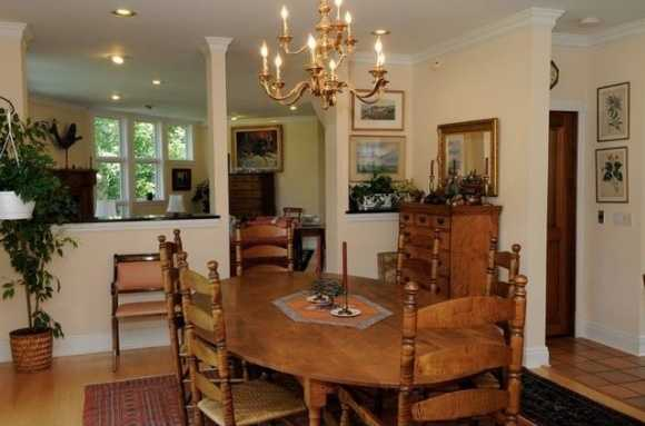 The kitchen overlooks a quaint dining area.