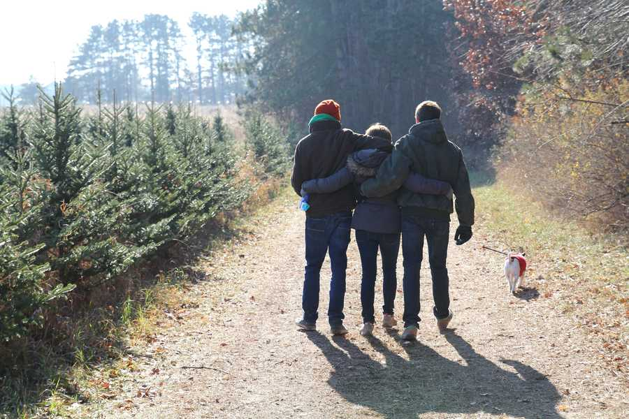 Every year, after Thanksgiving, my family goes to the same Christmas tree farm to cut down our own tree. We go with my cousins and aunts and uncles and make a day of it. Chuck loves to tag along!