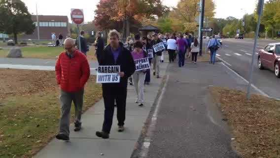 Teachers picket outside South Burlington High School on Dorset Street early Tuesday morning. It was the first day of their strike.