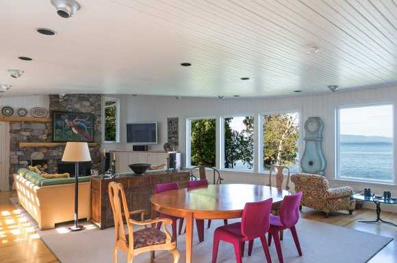 Floor to ceiling windows offer amazing, panoramic views of the lake and Adirondack mountains.