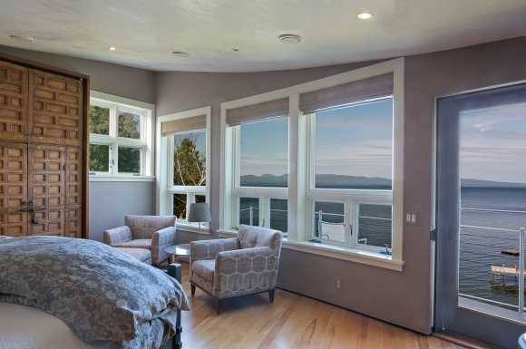 Wake up to breathtaking views in the master bedroom.