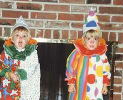 A few years later, Caitlin and her sister went as clowns. Is Caitlin the clown on the left or on the right?