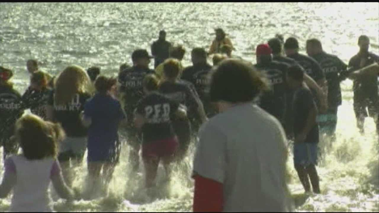 "November in Plattsburgh may not scream ""beach weather,"" but around 400 people in the North Country thought it was a perfect day to take a plunge and raise money for Special Olympics New York."