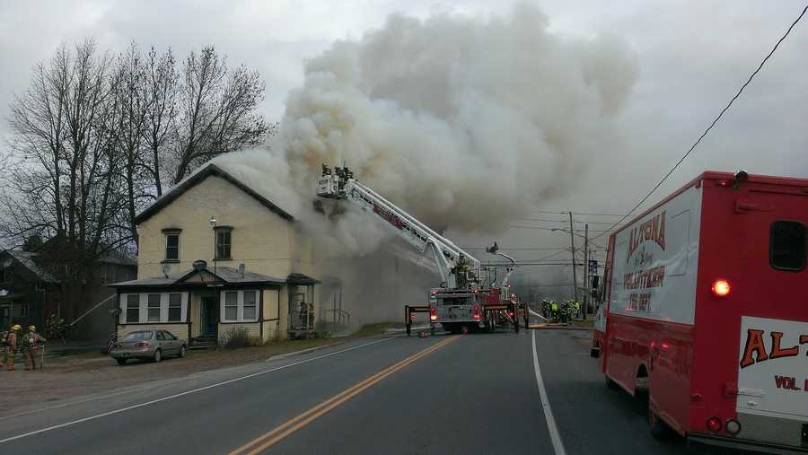 A quick spreading fire has destroyed a nine unit apartment building in Mooers, New York, displacing a dozen residents.