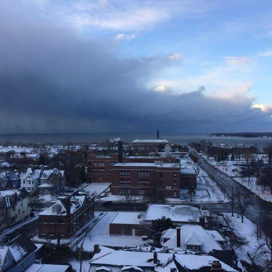 """Michelle Fatta: """"Porter Ave., Buffalo pics taken around 8:30 Tuesday morning. Epic snow band, looks like a massive wave about to engulf the city"""""""