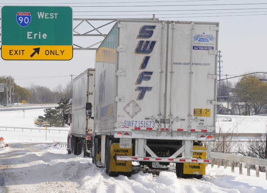 Truckers sit and wait in their tractor trailers for the New York State Thruway to reopen Wednesday, Nov. 19, 2014, at an entrance ramp in Cheektowaga, N.Y.