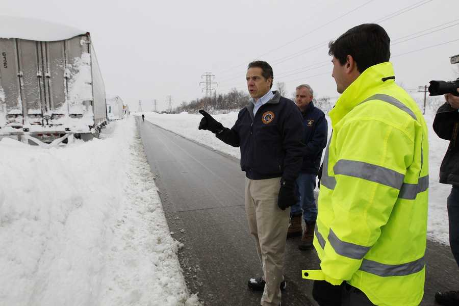 Dozens of trucks remained stranded on the New York State Thruway south of Buffalo after as much as six feet of snow fell.