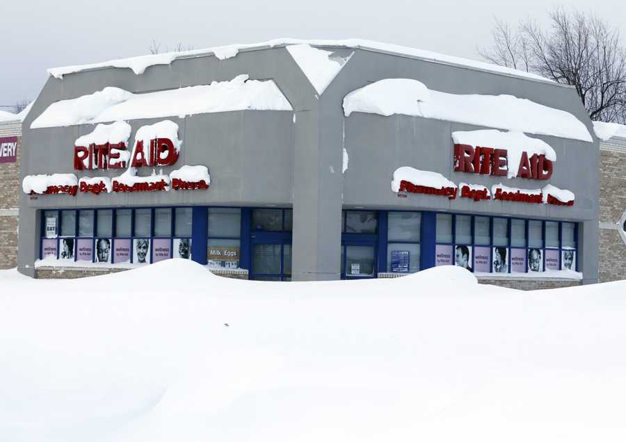 A Rite Aid store is covered in snow in the south Buffalo area on Thursday, Nov. 20, 2014, in Buffalo, N.Y.