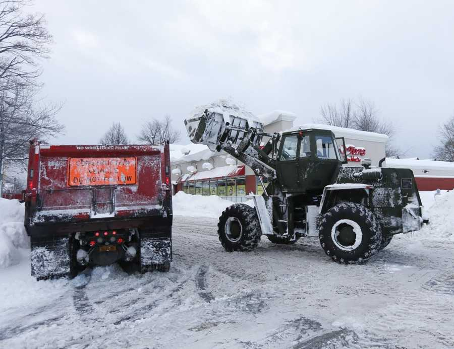 A New York National Guard vehicle loads snow into a dump truck while clearing streets in the south Buffalo area on Thursday, Nov. 20, 2014, in Buffalo, N.Y.