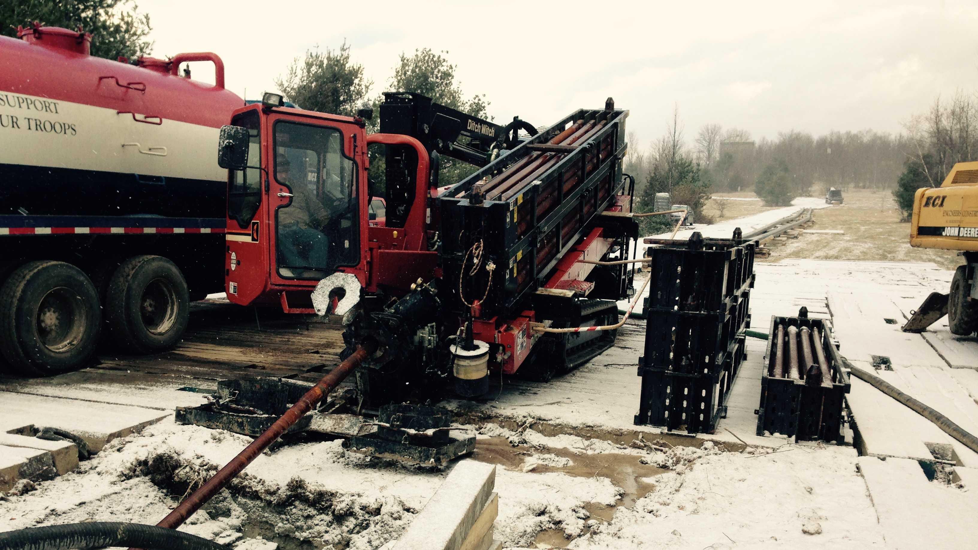 Contractors drill pilot hole for gas pipeline under Interstate 89 in Williston.