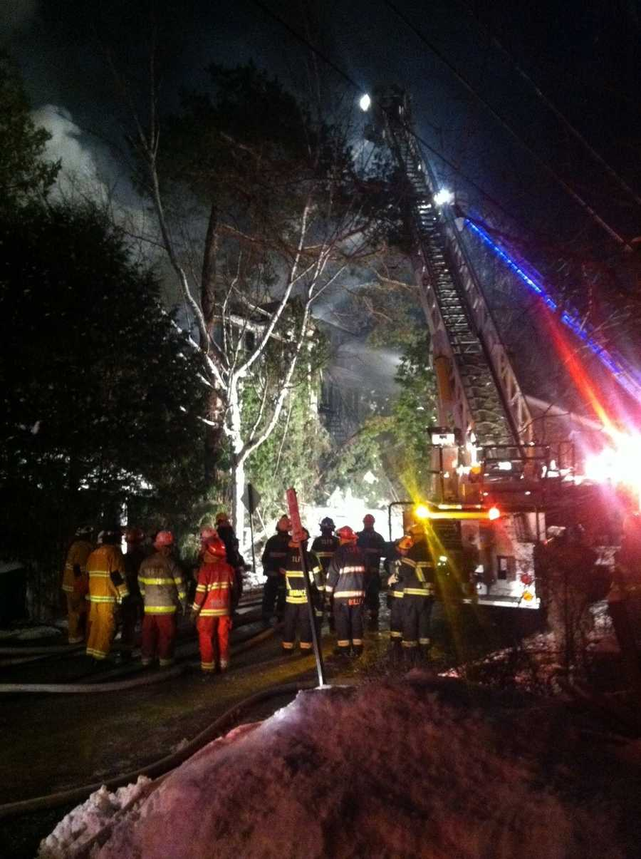 Crews battle an early morning house fire on Riverside Drive in Saranac Lake
