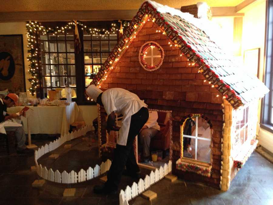 Lerome Campbell is the pastry chef at Vermont's Woodstock Inn and resort. His team's creation in the inn's lobby-- some three weeks in the making -- is 9 feet tall from foundation to rooftop and 7 feet long with ceilings high enough for most people to carefully stand up in.