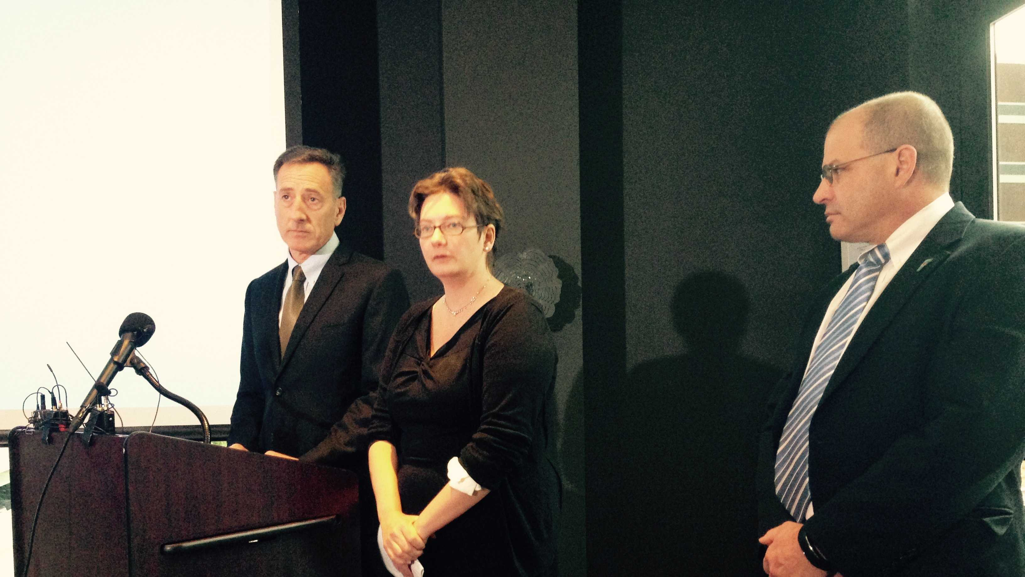 Gov. Peter Shumlin, left, with health care reform advisers Robin Lunge and Lawrence Miller at a news conference at Hotel Vermont Wednesday in Burlington.