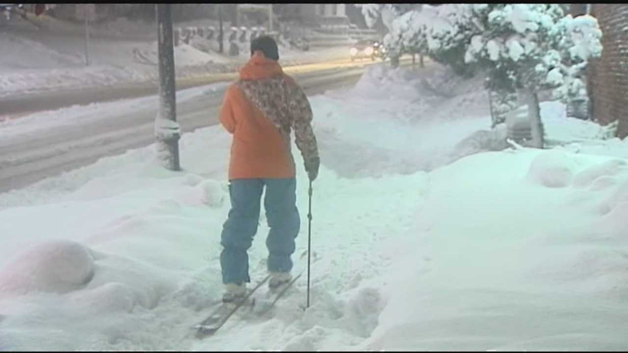 Adam Newhard ditches his car and put on his skis to travel through Burlington.