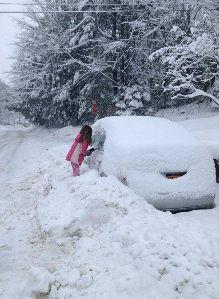 Danielle in Saranac Lake is teaching this little one early: always keep a scraper in your car! You may even need it in April around these parts!