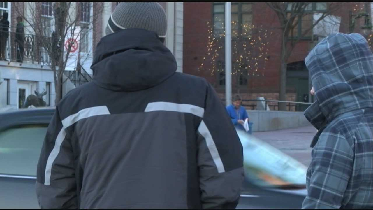 The colder temperatures in Vermont are forcing people who are outside to bundle up.