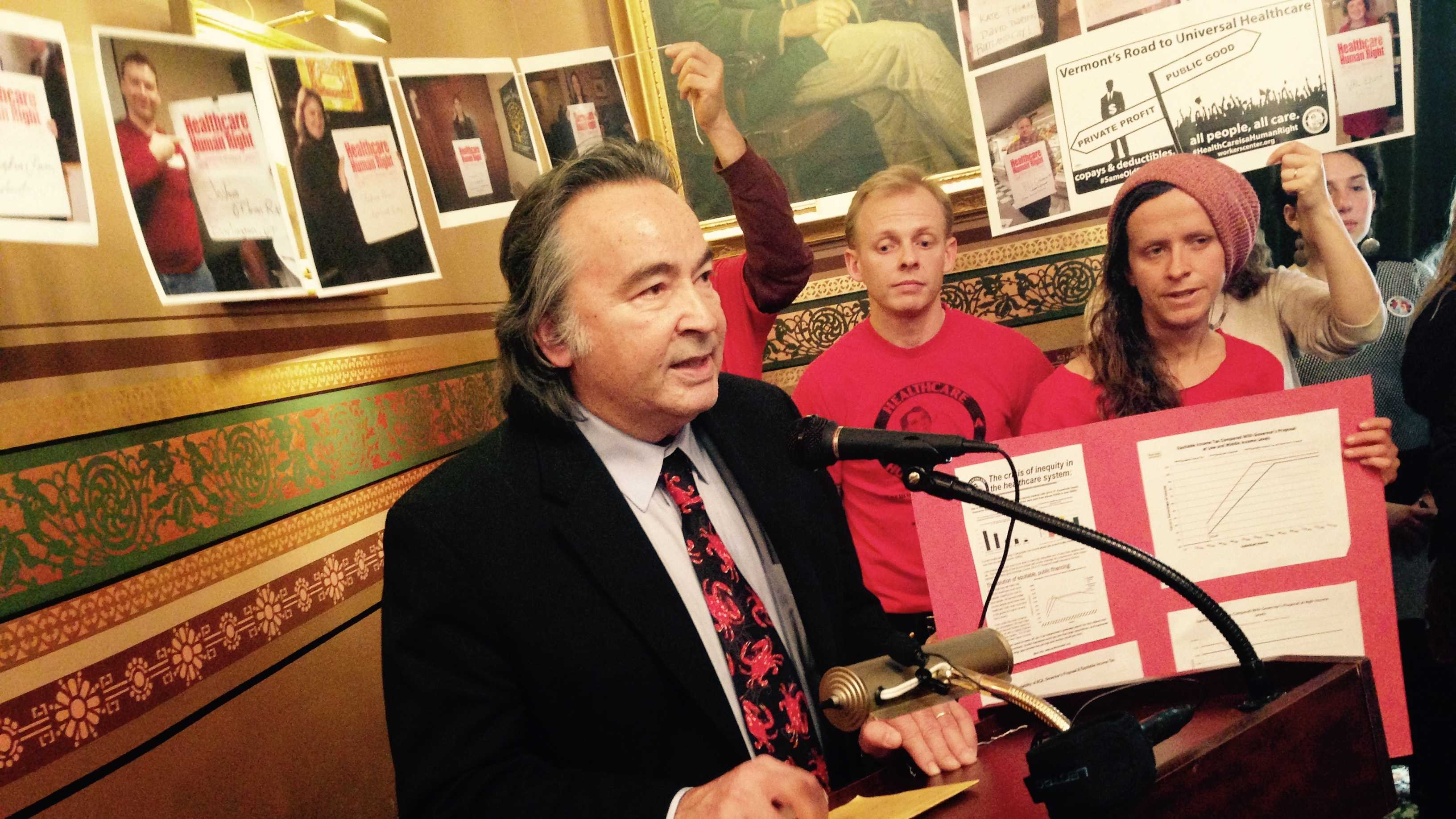 Sen. Anthony Pollina speaks Thursday at a Statehouse rally intended to advance universal health care reform this year.