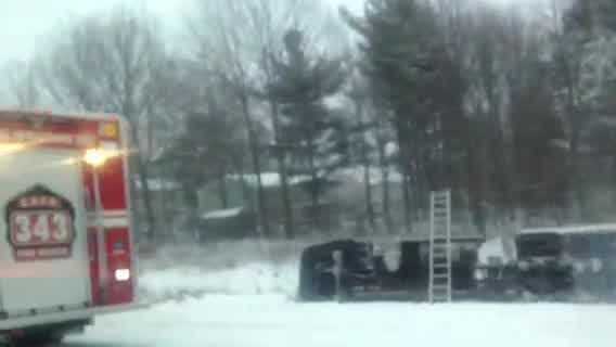 Crews to remove a tractor-trailer that ended up on its side off of the interstate Monday afternoon.