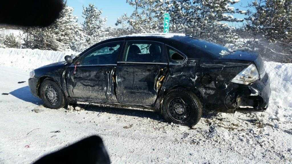 A tractor-trailer hit a Vermont State Police car from behind Tuesday morning. The