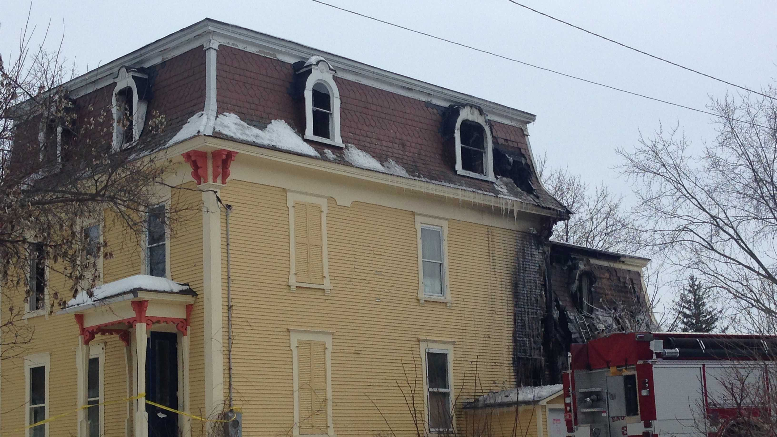 Firefighters worked late Saturday night into Sunday morning after a fire destroys an old apartment building.